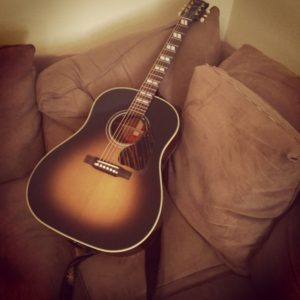 All a fella needs is a couch and a guitar.