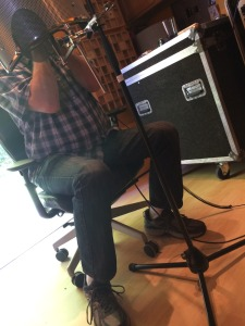 Mystery harmonica player in the studio. You want to know who it is- wait to buy the record.